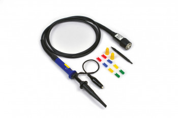 A passive oscilloscope probe with BNC connector with it's kit contents, cable coiled up.