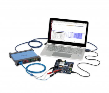 PicoScope 4444 oscilloscope with accessories, a laptop showing Linux PicoScope 6 software
